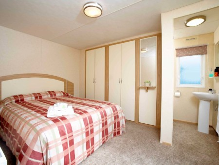 Master bedroom in a pre-owned caravan