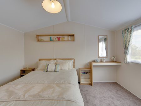Master bedroom in a new caravan