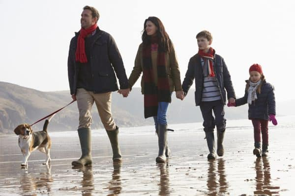 Family enjoying beachside holiday in autumn - book a Pease Bay break from just £99