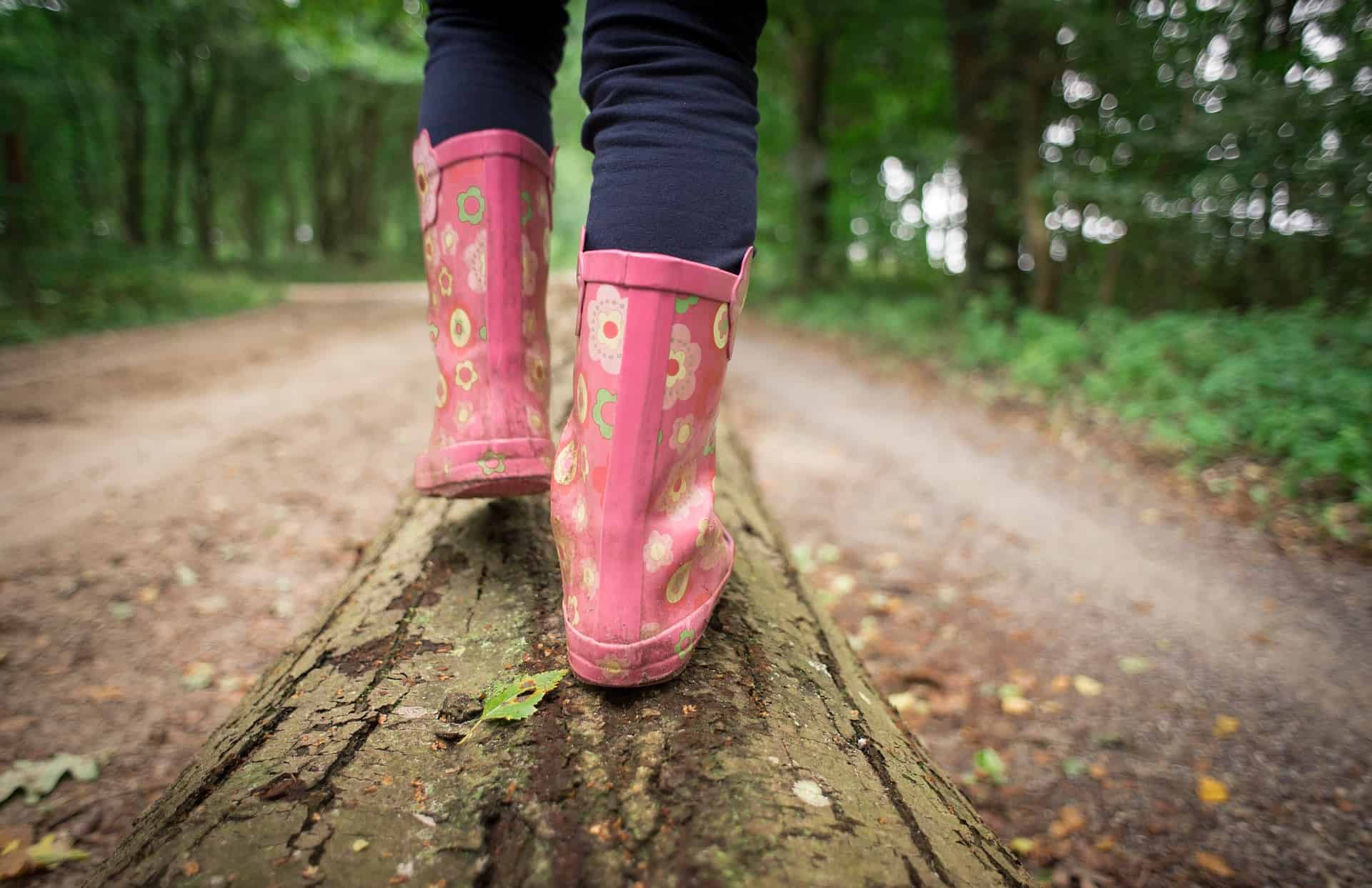 Girl walking in the outdoors in wellies