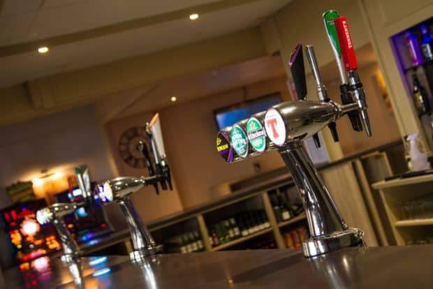 Enjoy a wide selection of drinks in the bar at Pease Bay