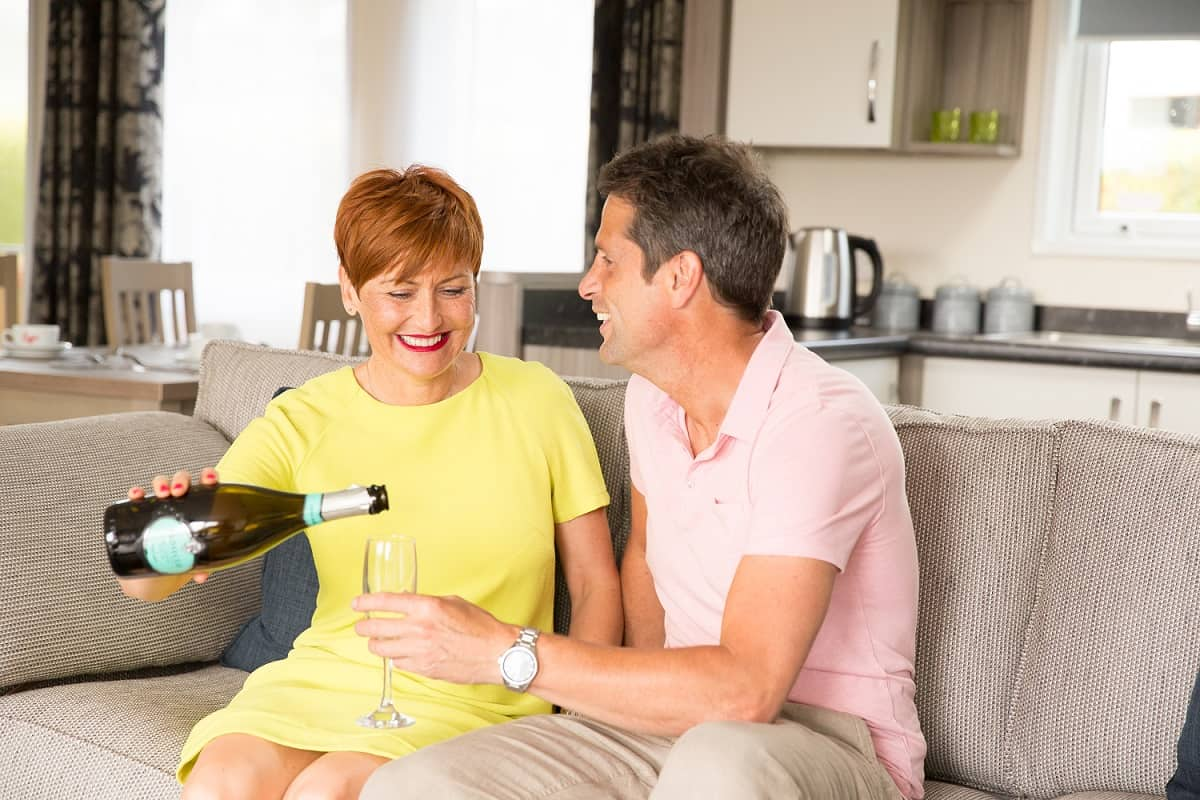 Couple enjoying holiday home living in lodge