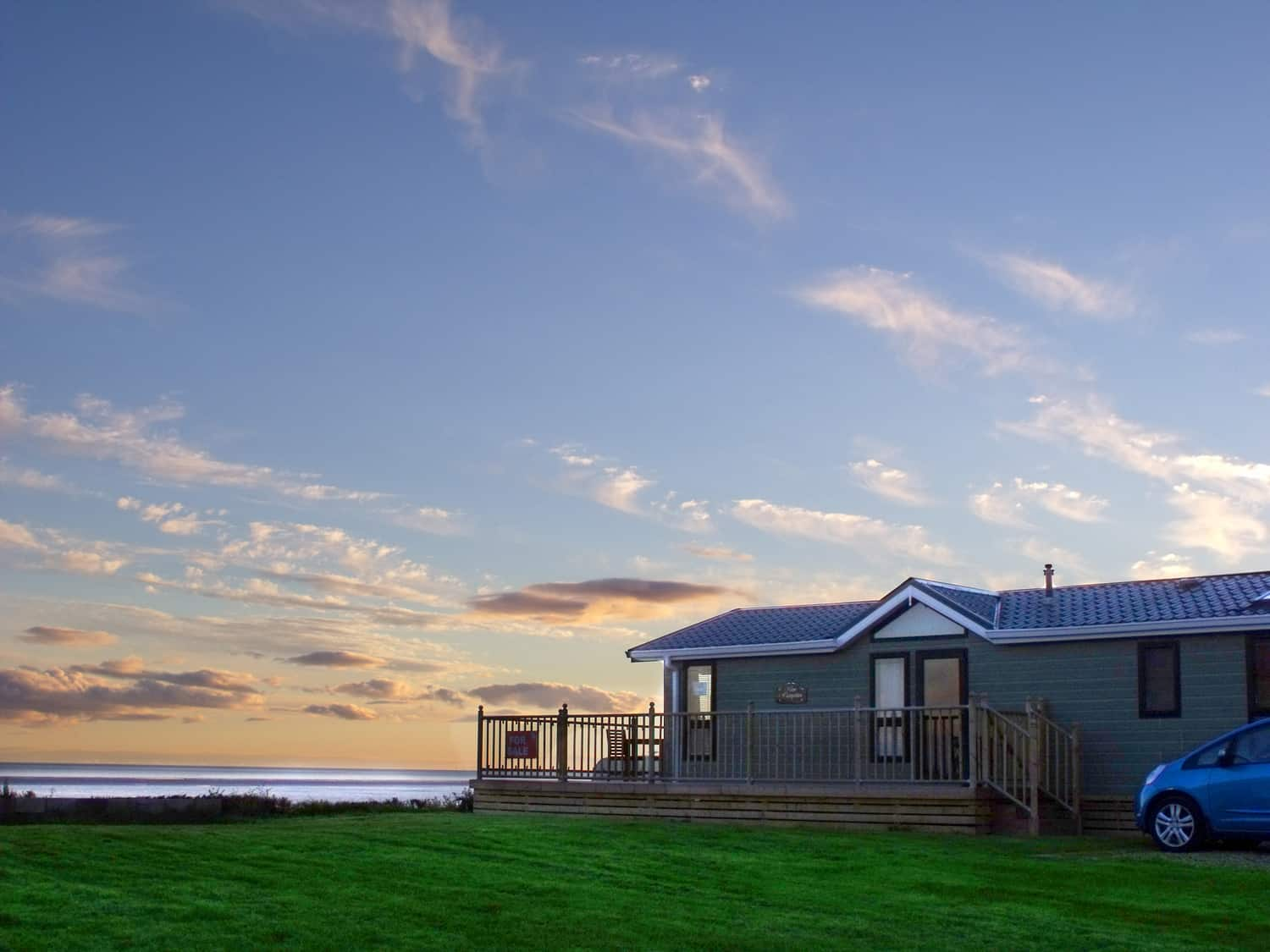 Lodge looking over the sea at Queensberry Bay